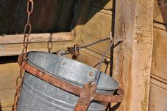 Hook and bucket in wooden moldavian water well Royalty Free Stock Image