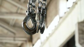 Hook and chain from the crane. At the plant. Close-up. Manufacture of reinforced concrete structures stock footage