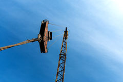 Hook of a construction crane on a wire blue background with a bl Stock Photography