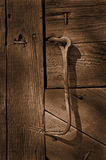 Hook on Door. Rusted hook used to close old barn door Stock Image