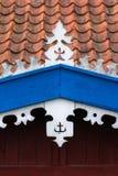 The hook - handmade decoration on fisherman`s house. White, oran royalty free stock image