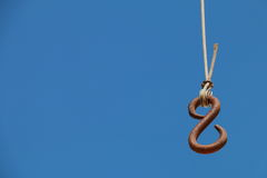 Hook. Hanging from a cable on a background of blue sky Royalty Free Stock Photos
