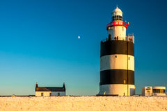 Hook Head lighthouse at sunset. Old lighthouse at Hook Head, county Wexford, Ireland Royalty Free Stock Photo