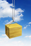 Hook holding wooden container Stock Photo