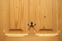 Hook for keys on the door Royalty Free Stock Photo