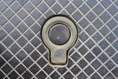 Hook on the manhole Royalty Free Stock Image