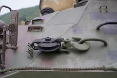 Hook and pulley of BTR 3E1 8×8-wheeled armored personnel carrier in jungle camouflage. Hook and pulley at the sideof BTR 3E1 8×8-wheeled armored personnel Stock Images