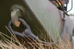 Hook and steel wire of BTR 3E1 8×8-wheeled armored personnel carrier in jungle camouflage. In the marine base`s field Royalty Free Stock Photos