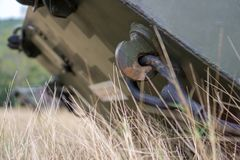 Hook and steel wire of BTR 3E1 8×8-wheeled armored personnel carrier in jungle camouflage. In the marine base`s field Royalty Free Stock Photo