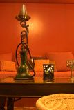 Hookah. Table width a big hookah in a sauna at the spa with intentionally dim lighting Royalty Free Stock Photography