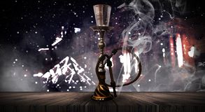 Hookah on the background of the night city, neon lights, with smoke. royalty free stock images