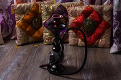 Hookah on a background of oriental cushions Royalty Free Stock Photo