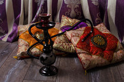 Hookah on a background of oriental cushions Stock Image