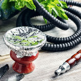 Hookah bowl with tobacco royalty free stock photography