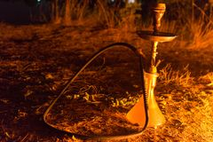 Hookah by the fire royalty free stock photos