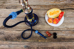 Hookah, fruit, berries. On old wooden background royalty free stock photos