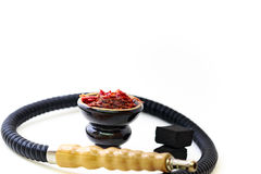 Hookah head, pipe, tobacco, and coals. Hookah head with tobacco inside and pipe and coals on the pure white background Royalty Free Stock Photo