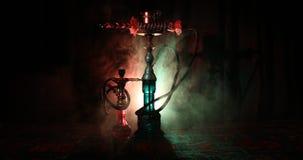 Hookah hot coals on shisha bowl making clouds of steam at Arabian interior. Oriental ornament on the carpet eastern tea ceremony. Hookah hot coals on shisha stock footage