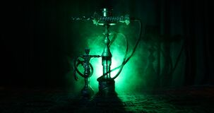 Hookah hot coals on shisha bowl making clouds of steam at Arabian interior. Oriental ornament on the carpet eastern tea ceremony. Hookah hot coals on shisha stock video footage
