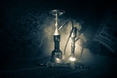 Hookah hot coals on shisha bowl making clouds of steam at Arabian interior. Oriental ornament on the carpet. Stylish oriental shis royalty free stock images