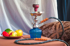 Hookah in interior. Smoking room. Relaxation and resting place. Stock Images