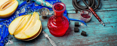 Hookah and melon. Melon variety of hookah tobacco and smoking accessories stock photos