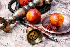 Hookah with orange taste Royalty Free Stock Photo
