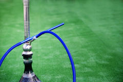 Hookah over green background Stock Images