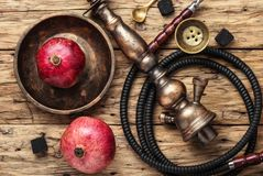Hookah with pomegranate flavor stock image
