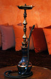 A hookah on a  red wall Royalty Free Stock Photos