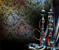 Hookah or Shisha. Two luxury Shisha pipes (Hookah) ready to smoke royalty free stock photo