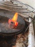 Hookah. Shisha charcoal going into fire stock images