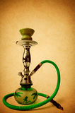 Hookah or Shisha on vintage texture background. Royalty Free Stock Photos