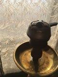 Hookah. Smoky hookah for a sweet smoke opposite the sun stock image