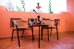 Hookah on table and chairs Royalty Free Stock Image