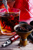 Hookah and tea Stock Photography