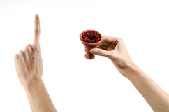 Hookah topic: Bartender holding a clay bowl with tobacco for hookah isolated on white background Stock Photography