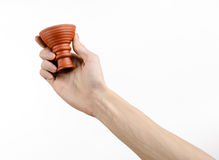 Hookah topic: Bartender holding a clay bowl for tobacco on a white background isolated Stock Photos