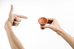 Hookah topic: Bartender holding a clay bowl for tobacco on a white background isolated Stock Image