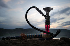 Hookah, traditional arabic waterpipe, direct sunset light, outdoor photo Royalty Free Stock Photo