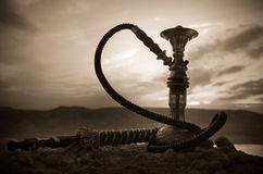 Hookah, traditional arabic waterpipe, direct sunset light, outdoor photo Stock Image