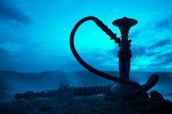 Hookah, traditional arabic waterpipe, direct sunset light, outdoor photo Stock Photos