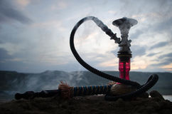 Hookah, traditional arabic waterpipe, direct sunset light, outdoor photo Stock Images
