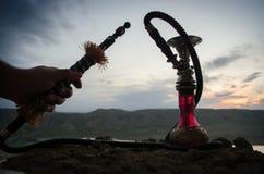 Hookah, traditional arabic waterpipe, direct sunset light, outdoor photo Stock Photo