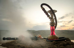 Hookah, traditional arabic waterpipe, direct sunset light, outdoor photo Royalty Free Stock Images