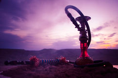Hookah, traditional arabic waterpipe, direct sunset light, outdoor photo Stock Photography