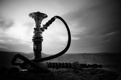 Hookah, traditional arabic waterpipe, direct sunset light, outdoor photo Royalty Free Stock Photography