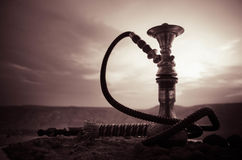 Hookah, traditional arabic waterpipe, direct sunset light, outdoor photo Royalty Free Stock Photos