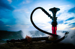 Hookah, traditional arabic waterpipe, direct sunset light, outdoor photo Royalty Free Stock Image