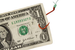 Hooked on Debt - Close Up. US Banknote Caught On Hook royalty free stock photos